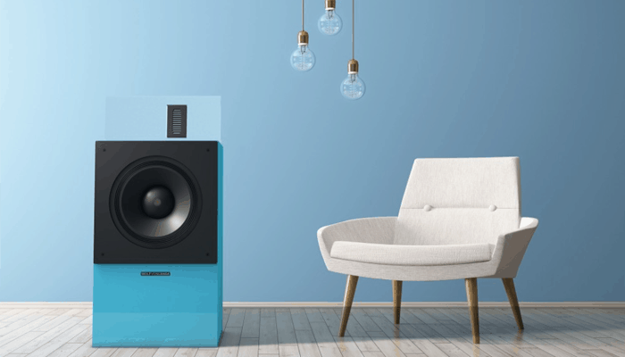blue floor speaker beside a white chair